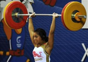 success for woman weight lifter