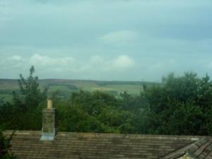 View over rooftop to moor